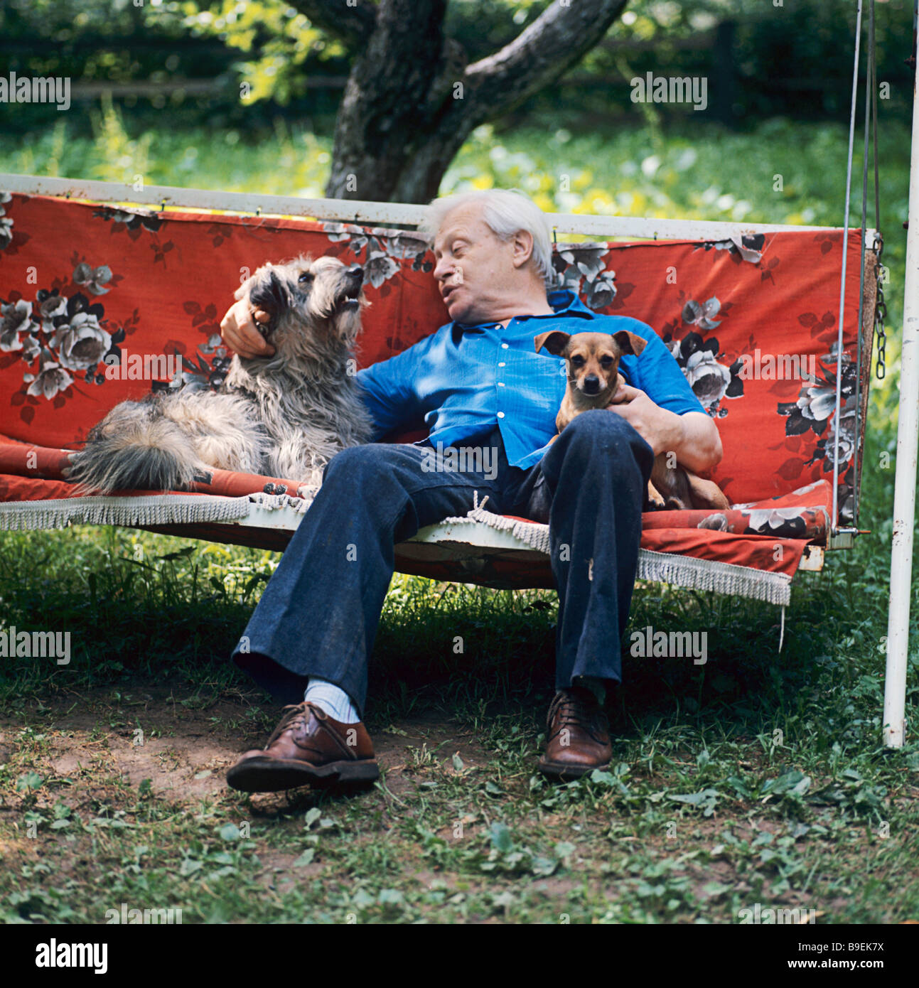 Sergei Obraztsov the head of the Moscow Puppet Theater sitting with his pets at his dacha near Moscow - Stock Image