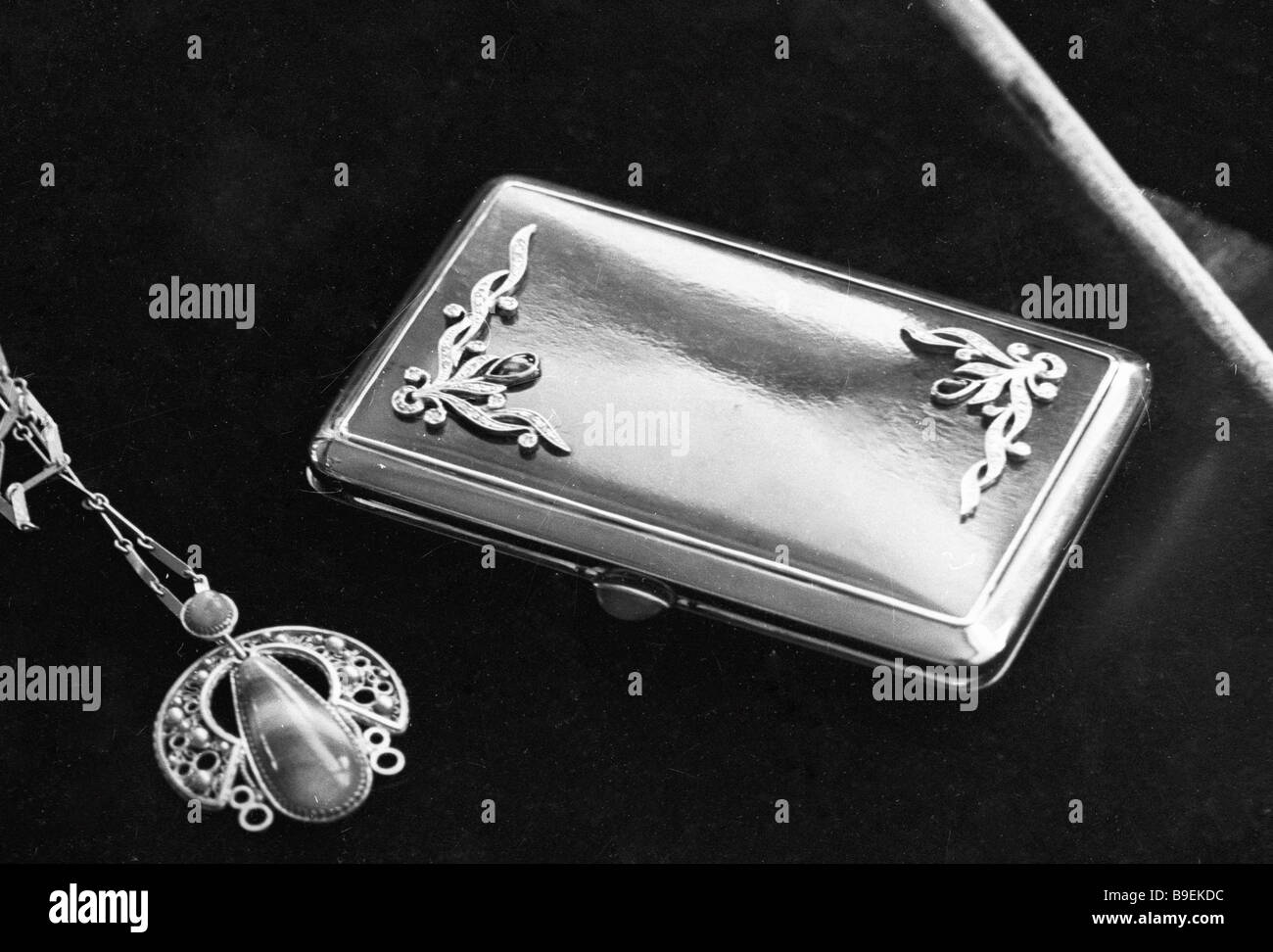 A pendant and a gold cigarette case Urals jewel factory produce - Stock Image