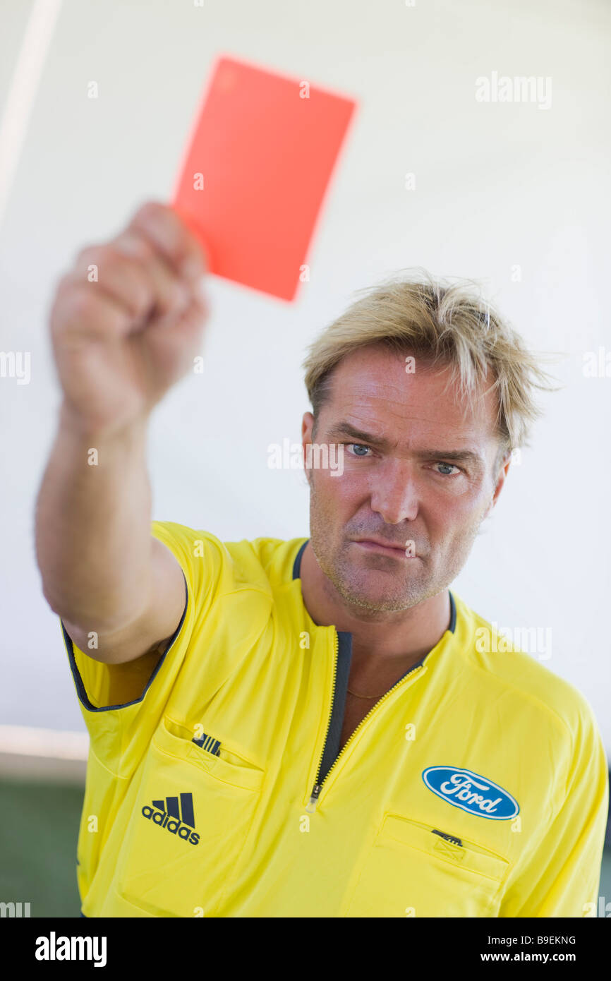 Referee Anders Frisk shows the red card. - Stock Image
