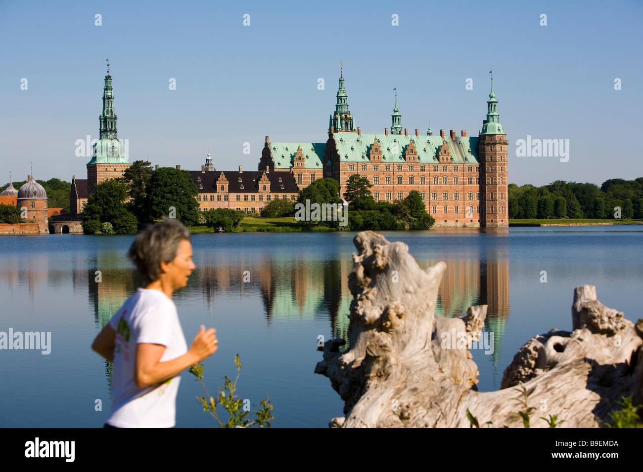 Jogging at Frederiksborg castle Hillerød Zealand Denmark - Stock Image