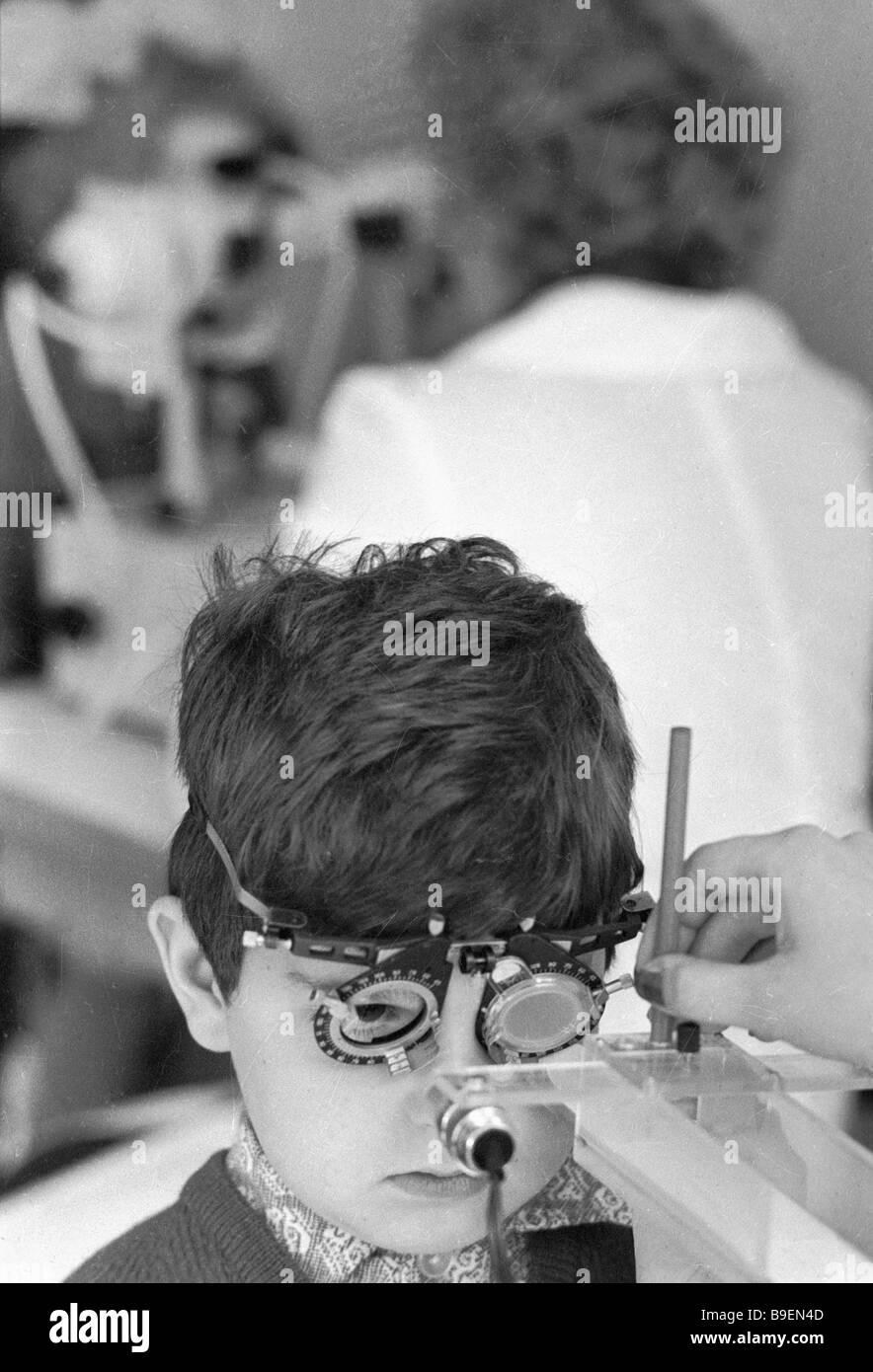 cf59a60144 A Helmholtz Ophthalmology Institute child patient has his eye examined with  an accommodometer - Stock Image