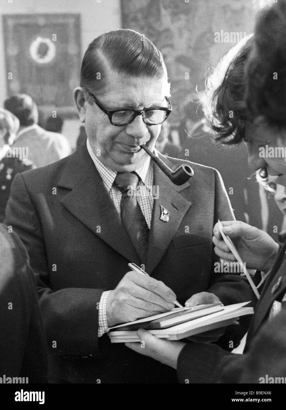 Chairman of the Communist Party of Finland Aarne Saarinen photographing during a break in the sessions of the 25th - Stock Image