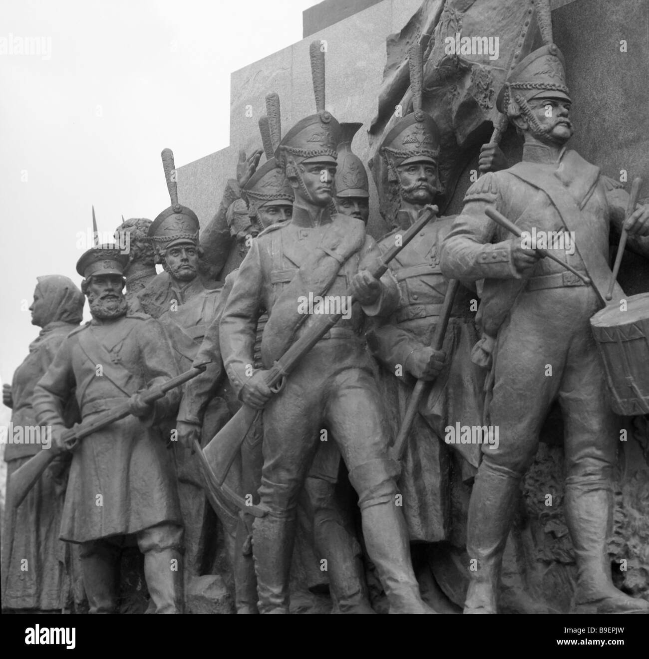 Sculptural composition featuring soldiers and partisans participants in the 1812 war on the pedestal of the monument - Stock Image