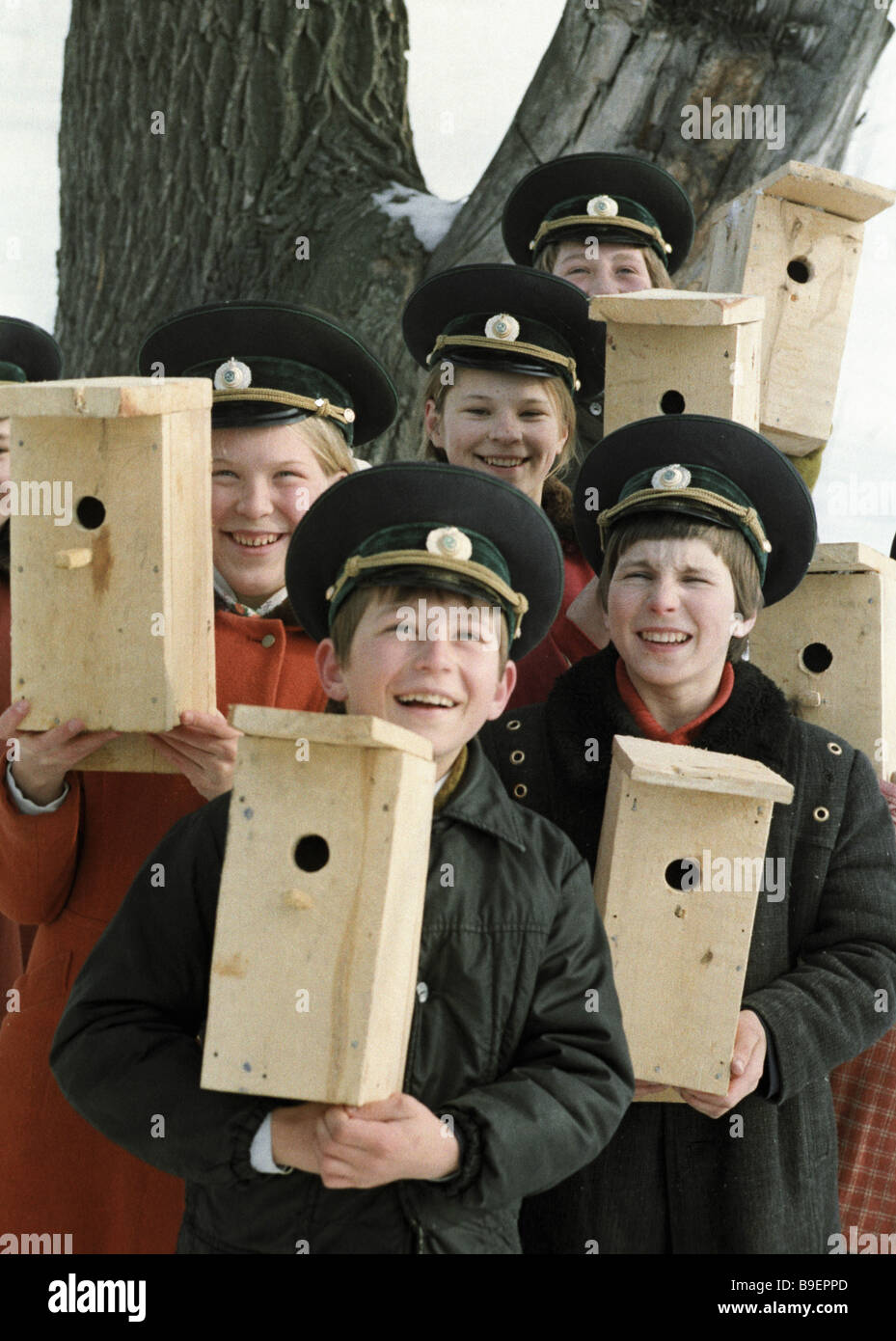 Lesovichok Wood sprite children s forestry club activists proud with starling houses of their own making - Stock Image