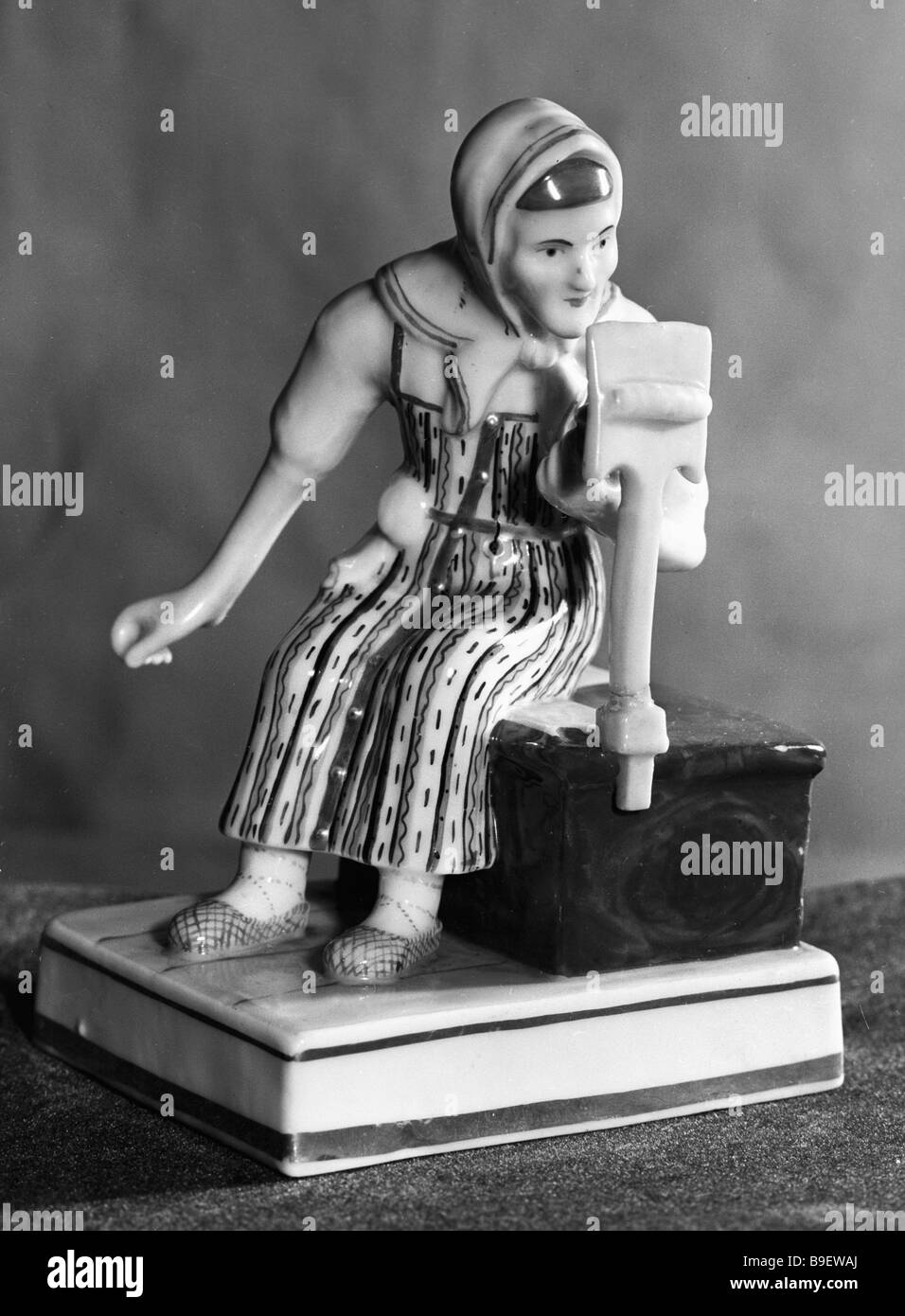 Porcelain statuette The Spinner from the Moscow Historical Museum - Stock Image