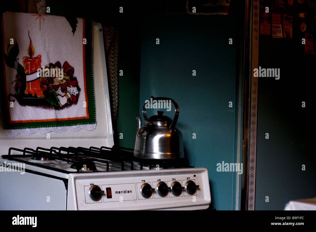 old kitchen with kettle over the stove - Stock Image