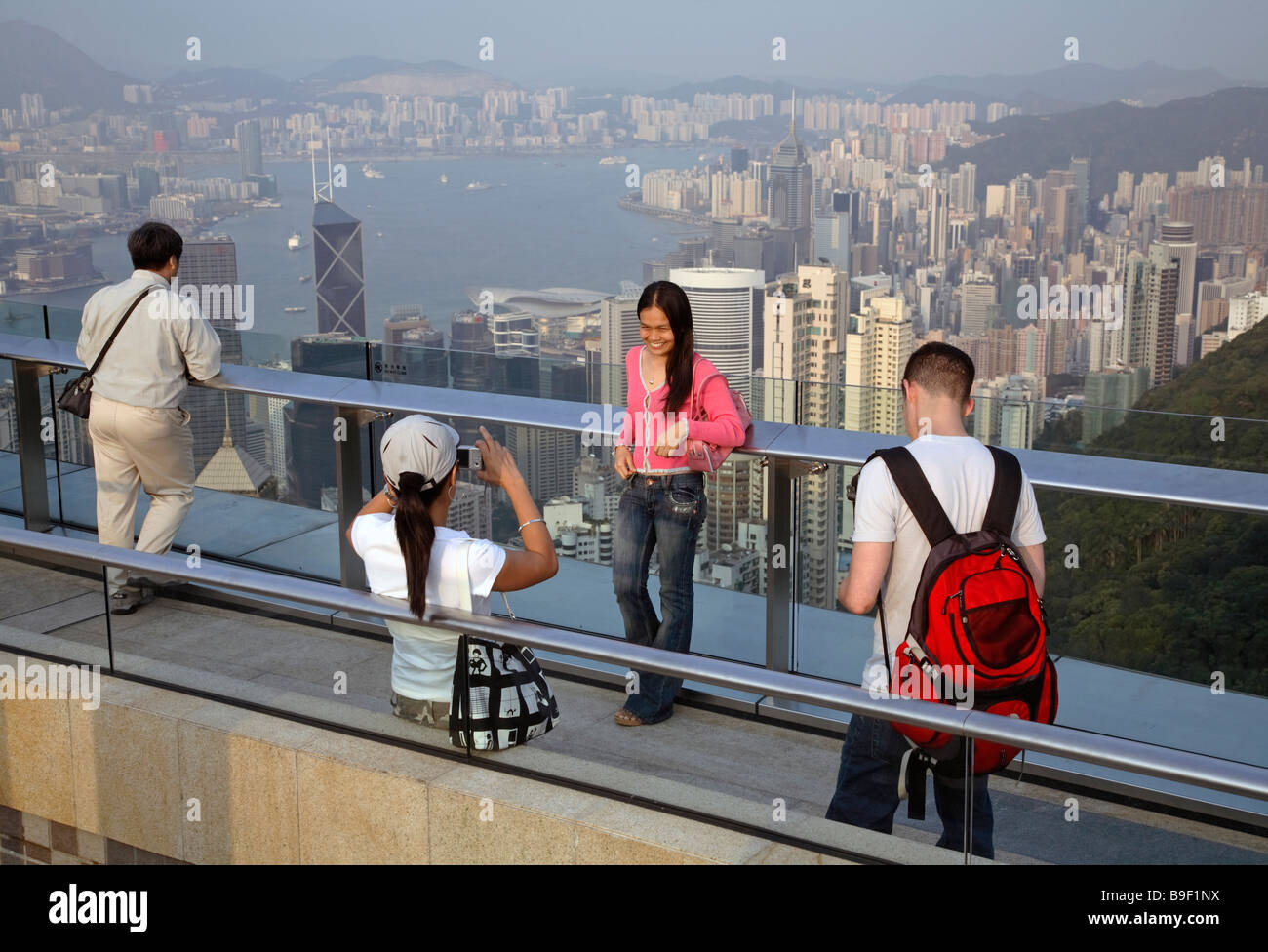 Tourists taking souvenir pictures from Hong Kong, China - Stock Image