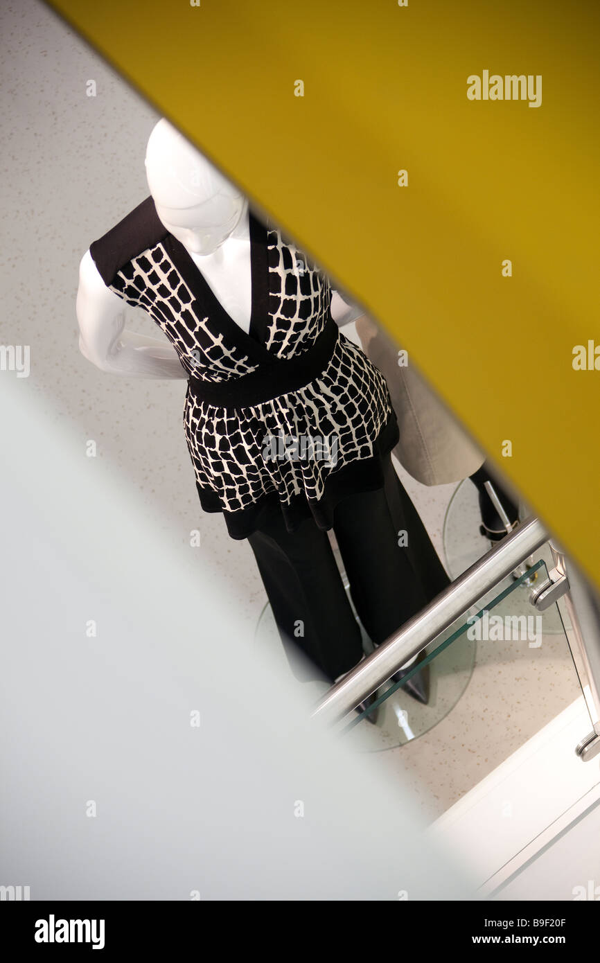 Shop mannequin in short sleeve black and white blouse and trousers - Stock Image