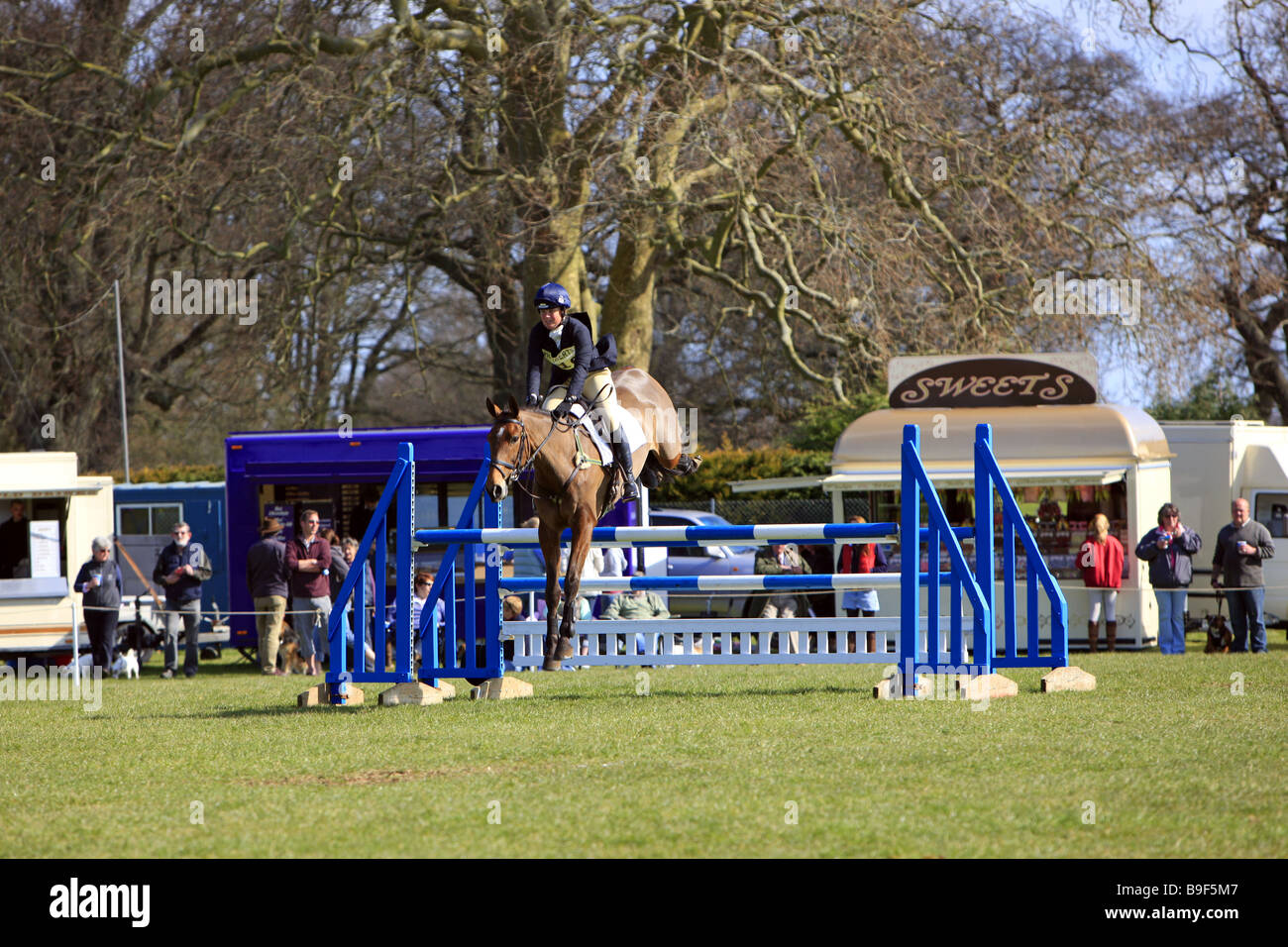 Female rider at a Horse Show Jumping event in rural England - Stock Image