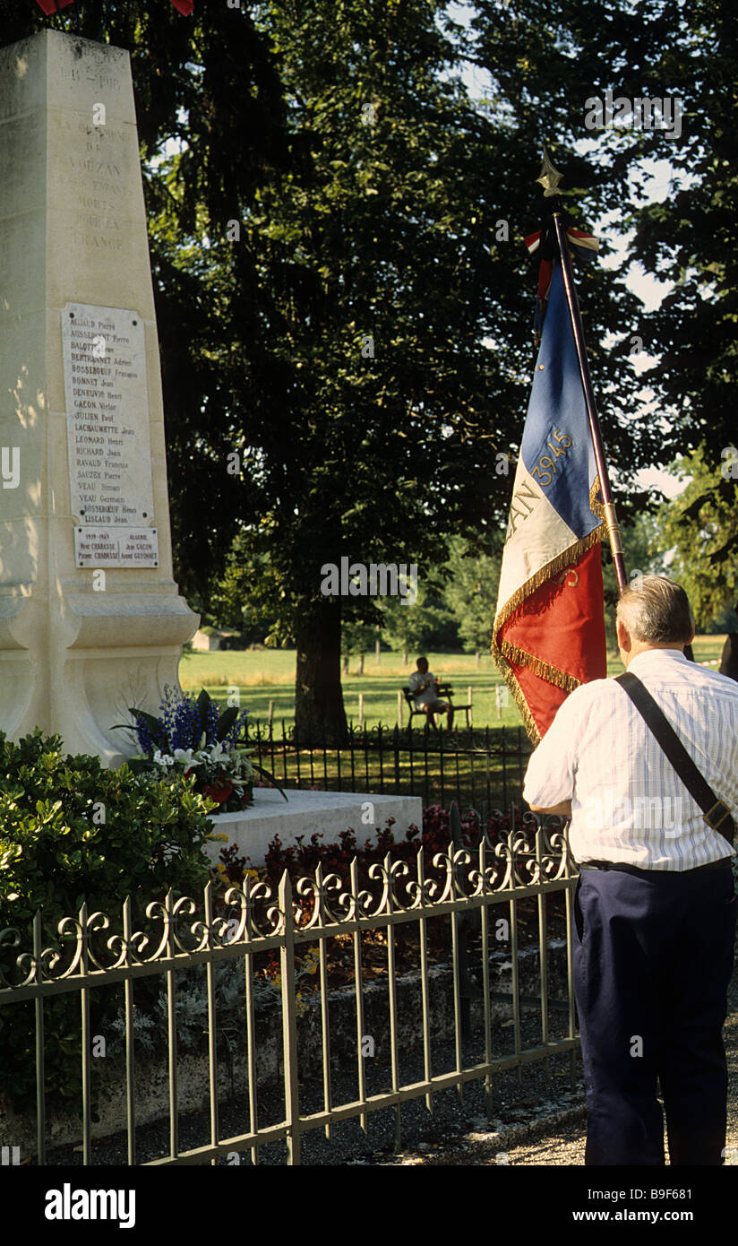 Vouzan, SW France. Bastille Day, 2005, ceremony at the village war memorial commemorating  local people who died Stock Photo