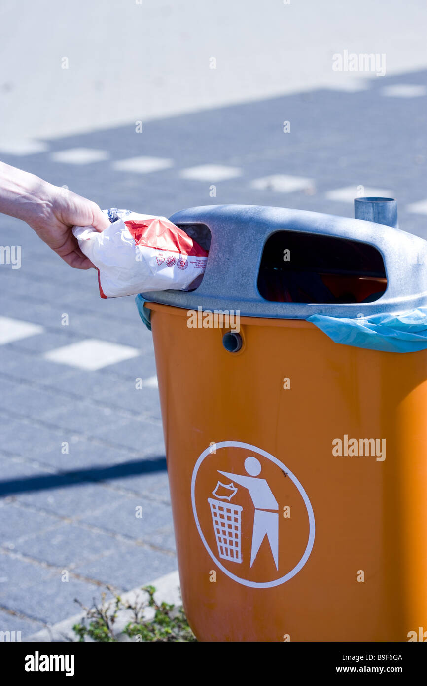 Discard roadside trash cans person waste detail hand - Stock Image