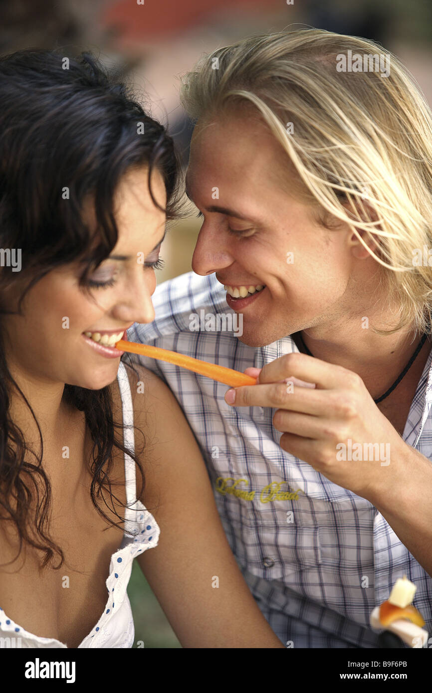 couple falling in love flirt vegetables eating cheerfully detail series people love-pair love affection proximity - Stock Image