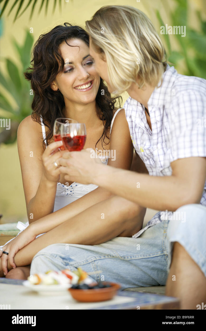 couple falling in love eye contact beverage holding cheerfully detail series people love-pair leisurewear love affection - Stock Image