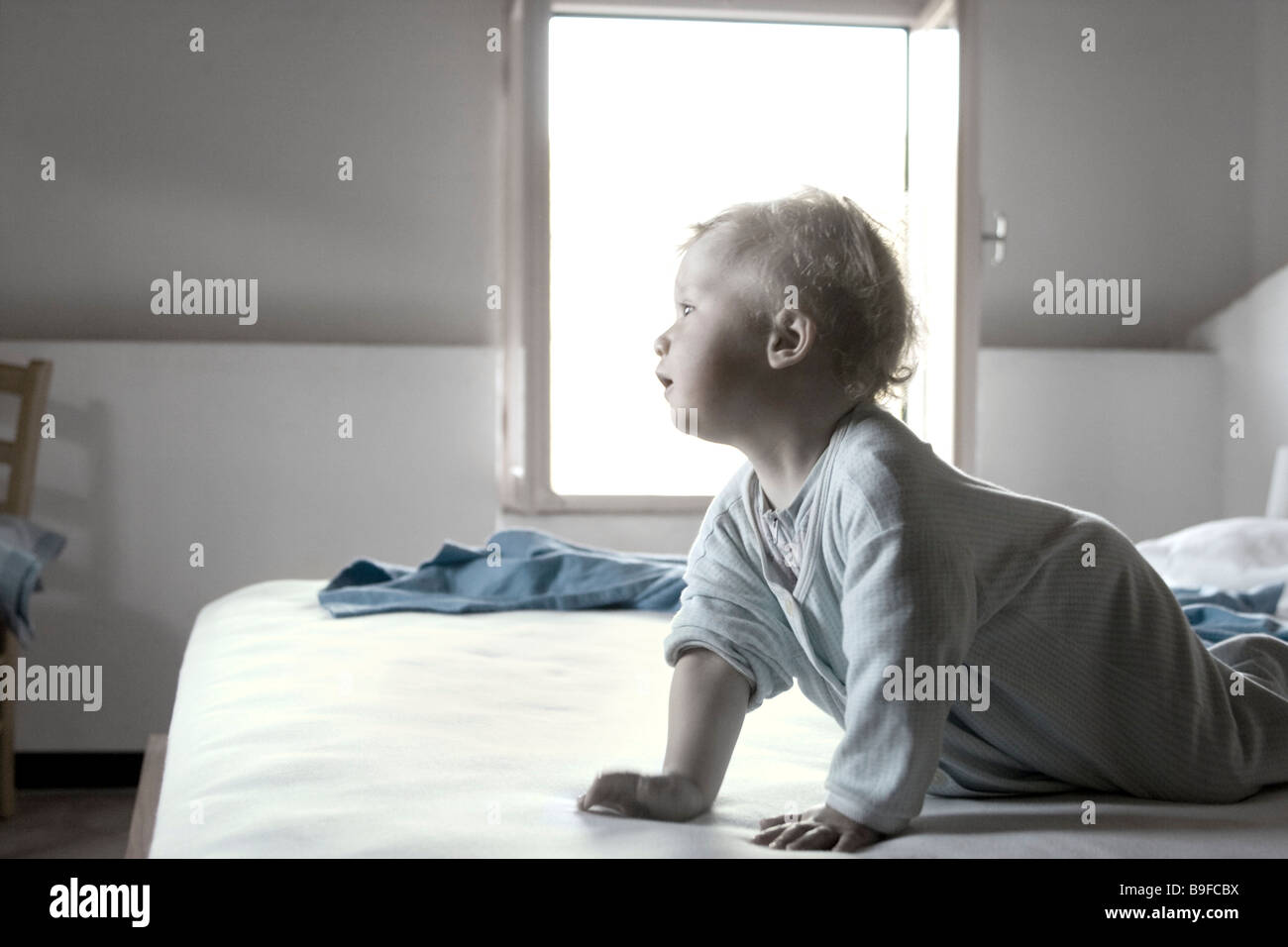 Baby toddling, low angle view - Stock Image