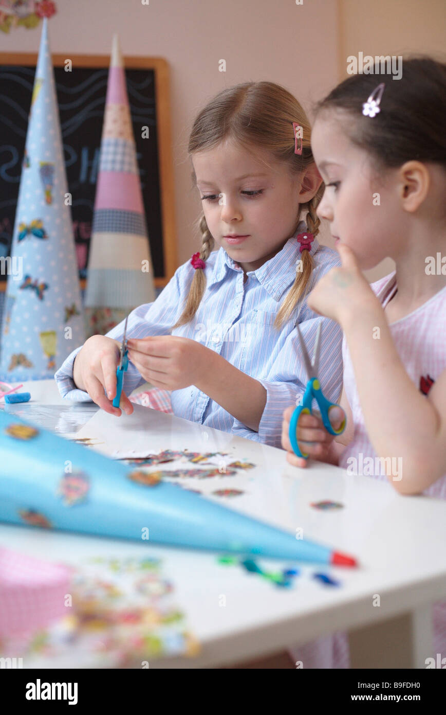 two girls with her cardbone cones - Stock Image