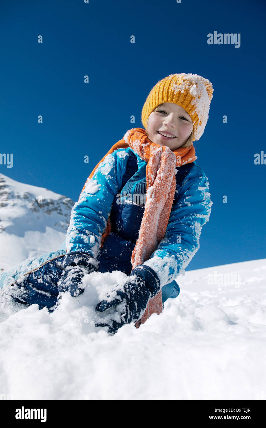 child playing in snow - Stock Image