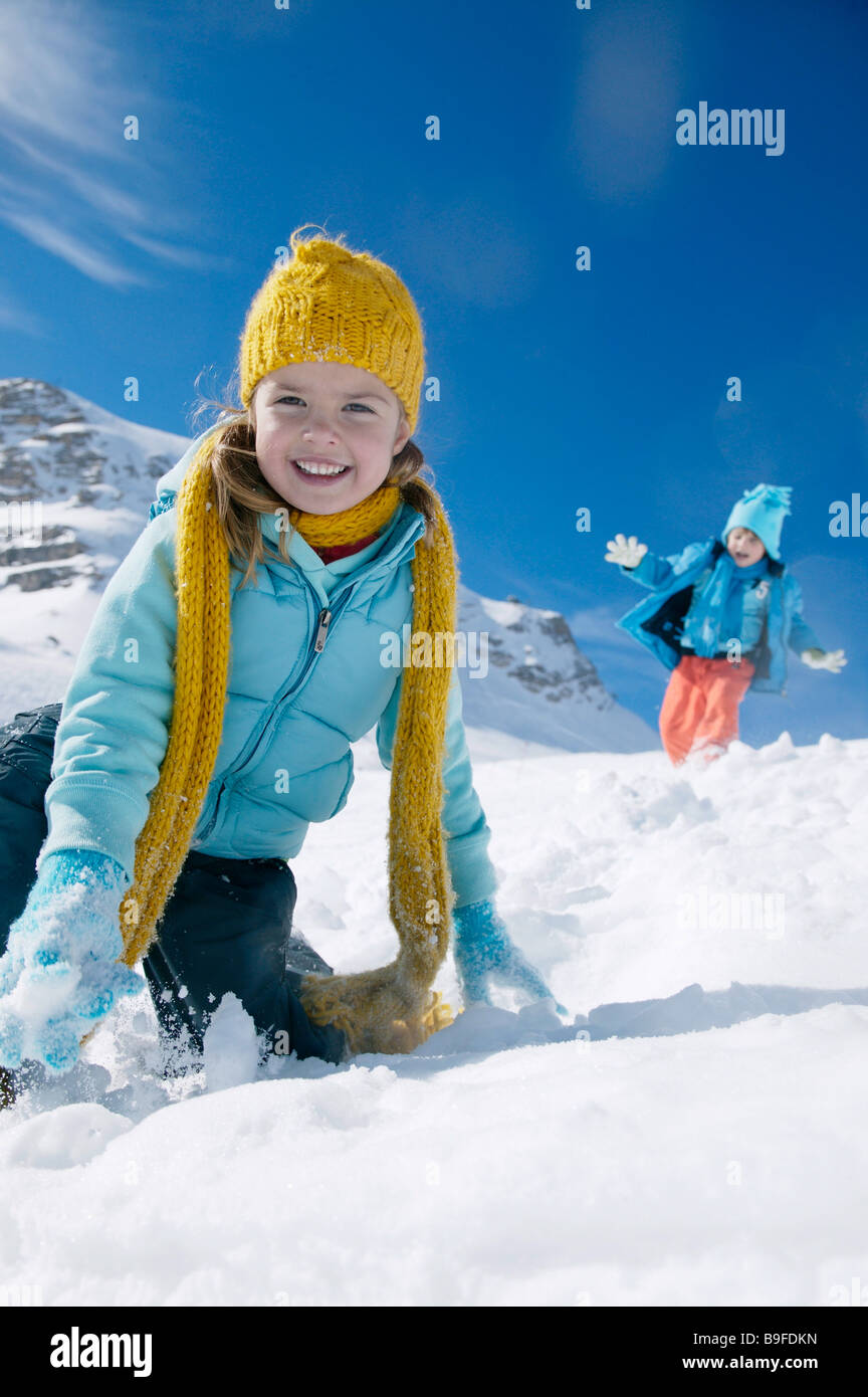 Portrait of girl smiling on snowcovered landscape - Stock Image