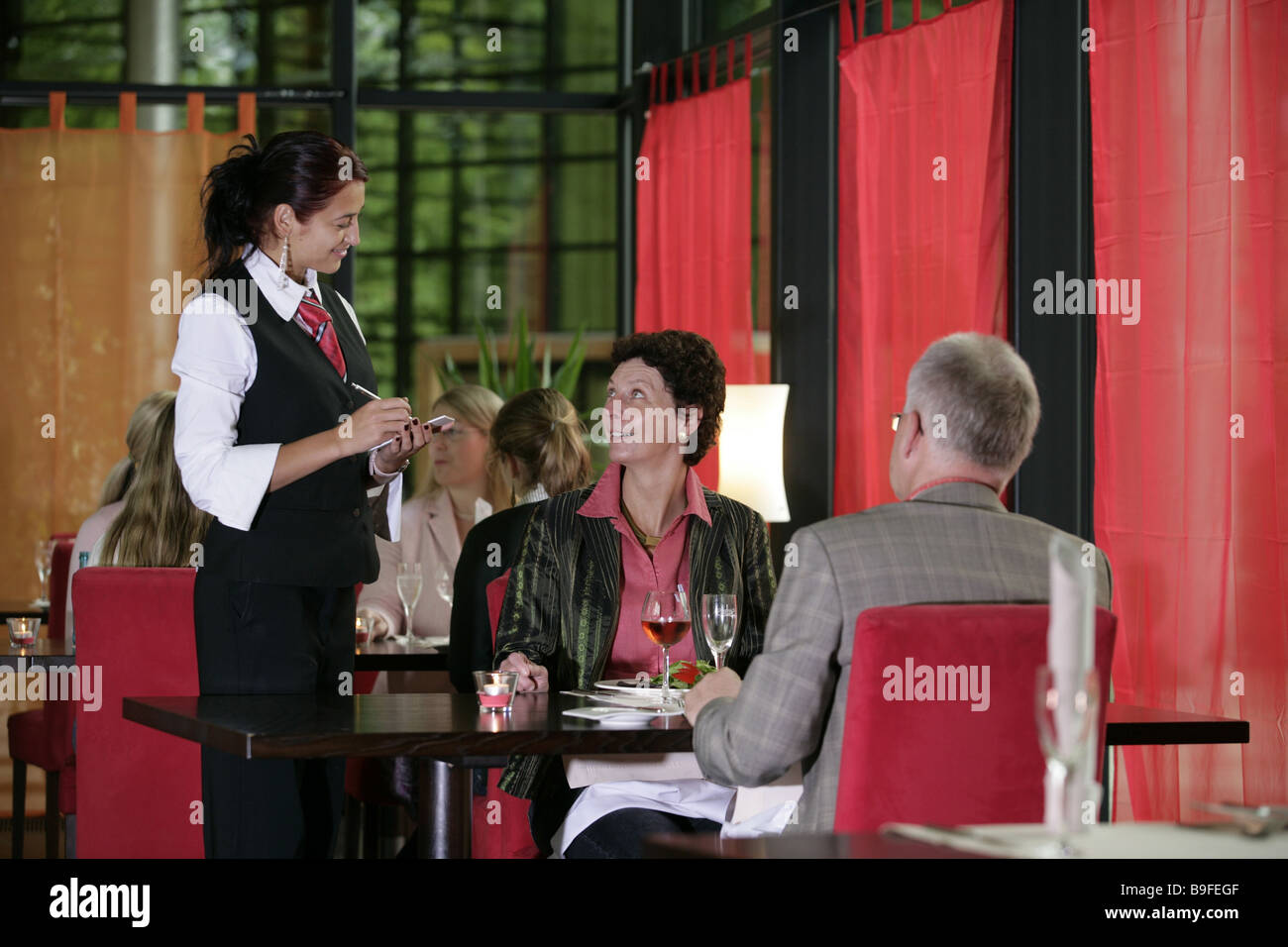 Germany Saarland Orscholz Cloef-Atrium restaurant couple service Employed architecture service occupation order - Stock Image