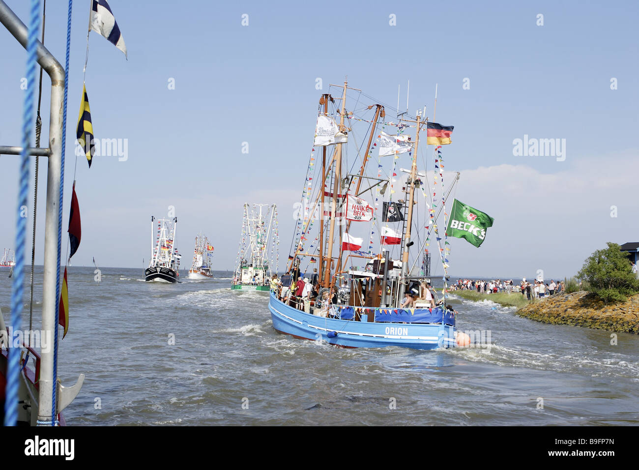Leakage visitors colorfully Butjadingen Germany shrinkage flags trip party fisher-boats haul fish-cutters flags - Stock Image