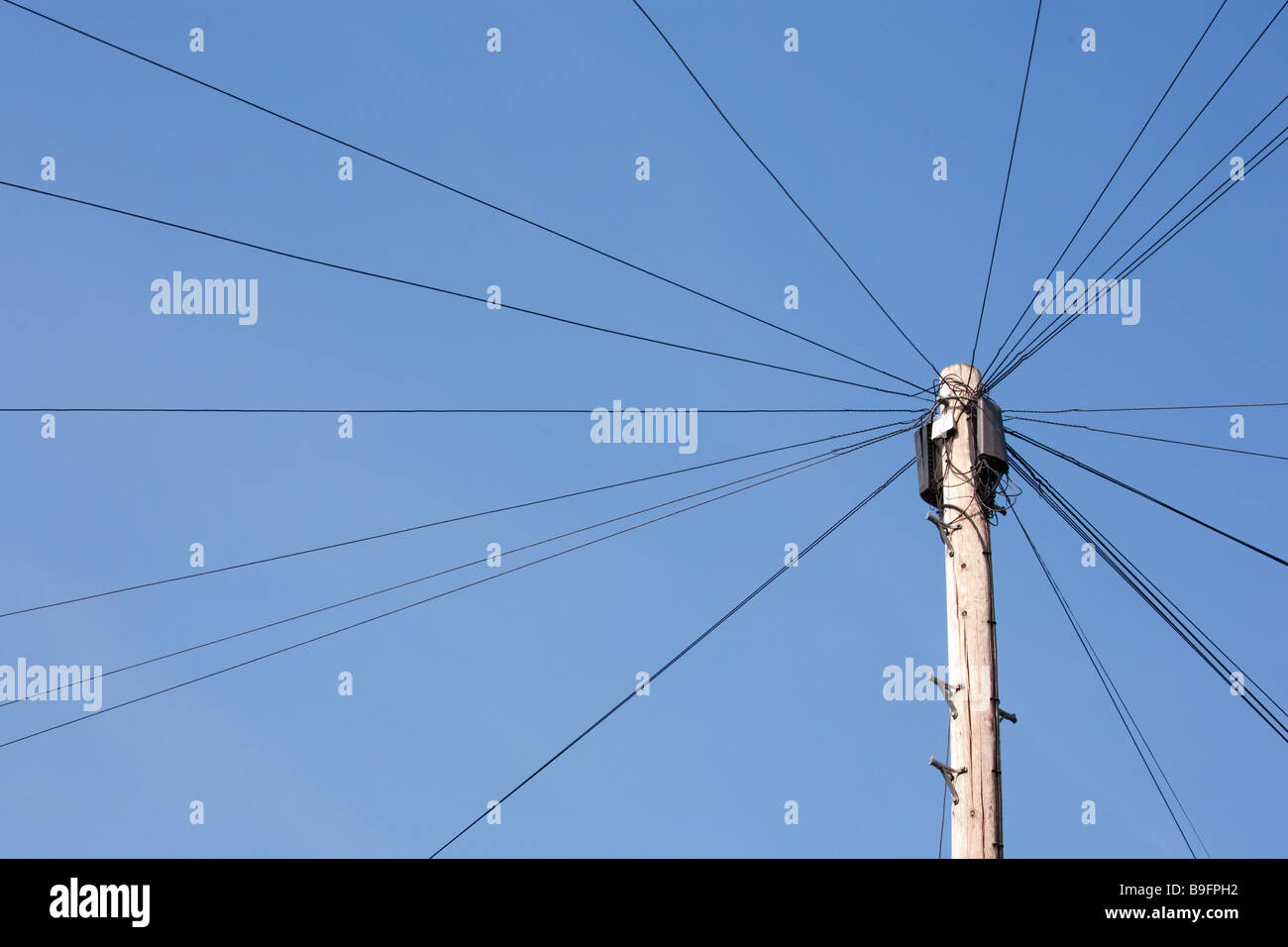 telephone (telegraph, uk) pole with wires radiating from it