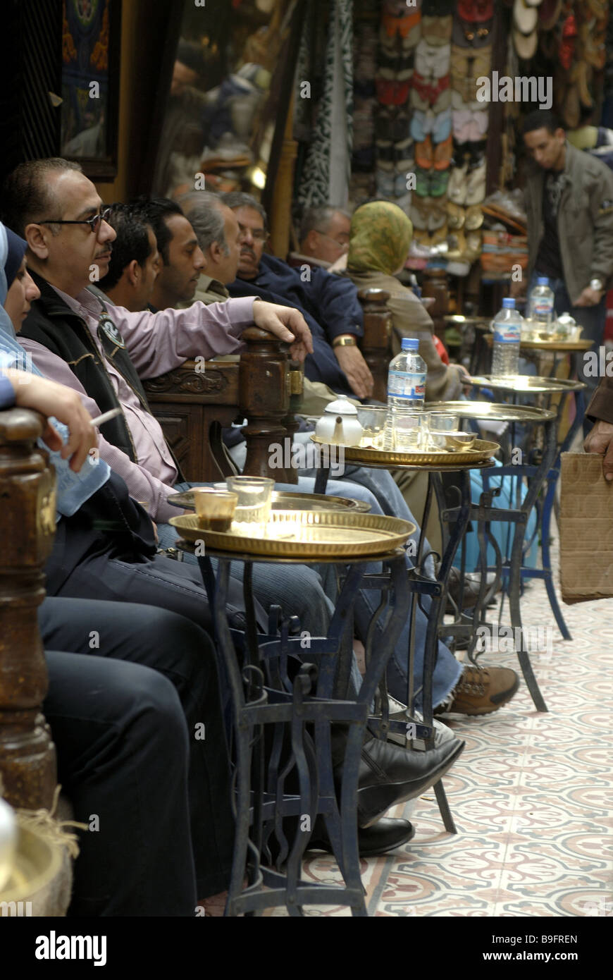 Egypt Cairo old town cafe guests Africa alley pub cafe tea-house people natives sitting recuperation relaxation - Stock Image