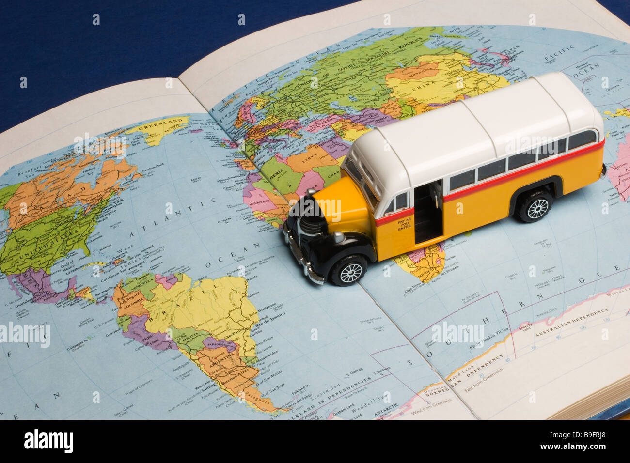 A toy bus on a world atlas book map stock photo 23090096 alamy a toy bus on a world atlas book map gumiabroncs Image collections