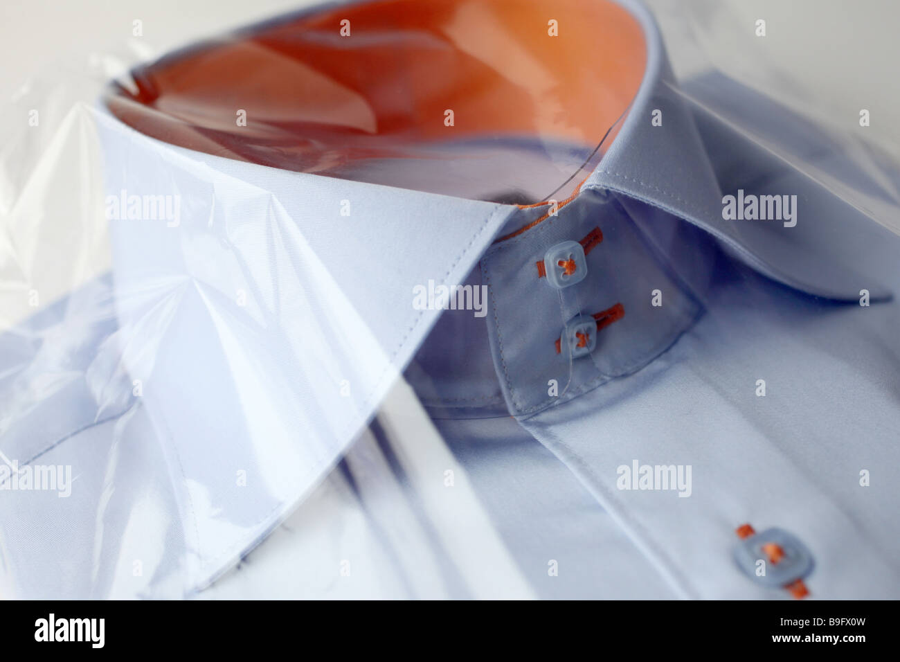 Men's shirts in its transparent packaging - Stock Image