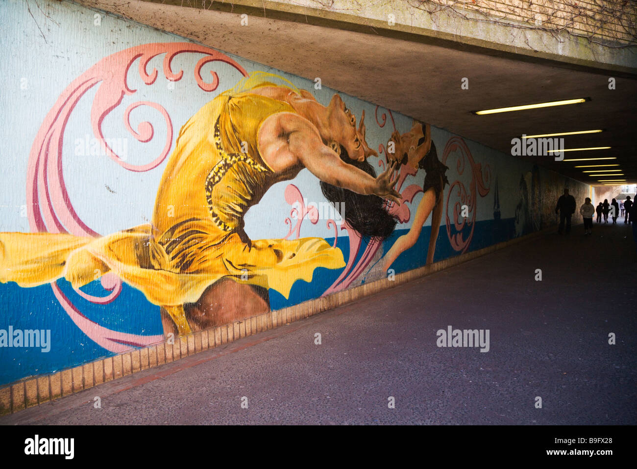 A mural depicting contemporary dance painted on the wall of the pedestrian underpass.  Weymouth seafront. Dorset. - Stock Image