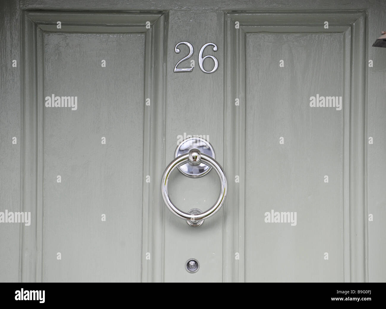 Attirant The House Number 26, A Peep Hole And A Door Knocker On The Painted Door
