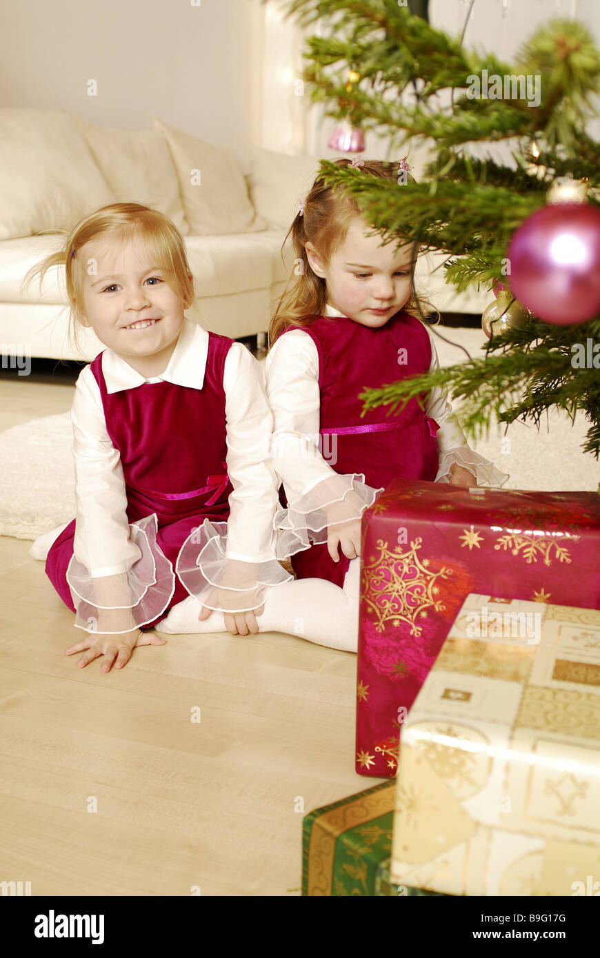 christmas girl two christmas-tree gifts series people children Stock ...