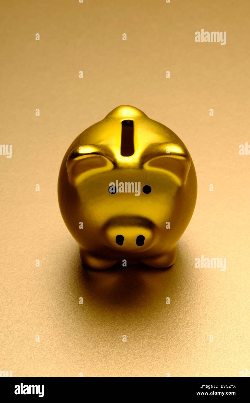 Gold piggy bank - Stock Image