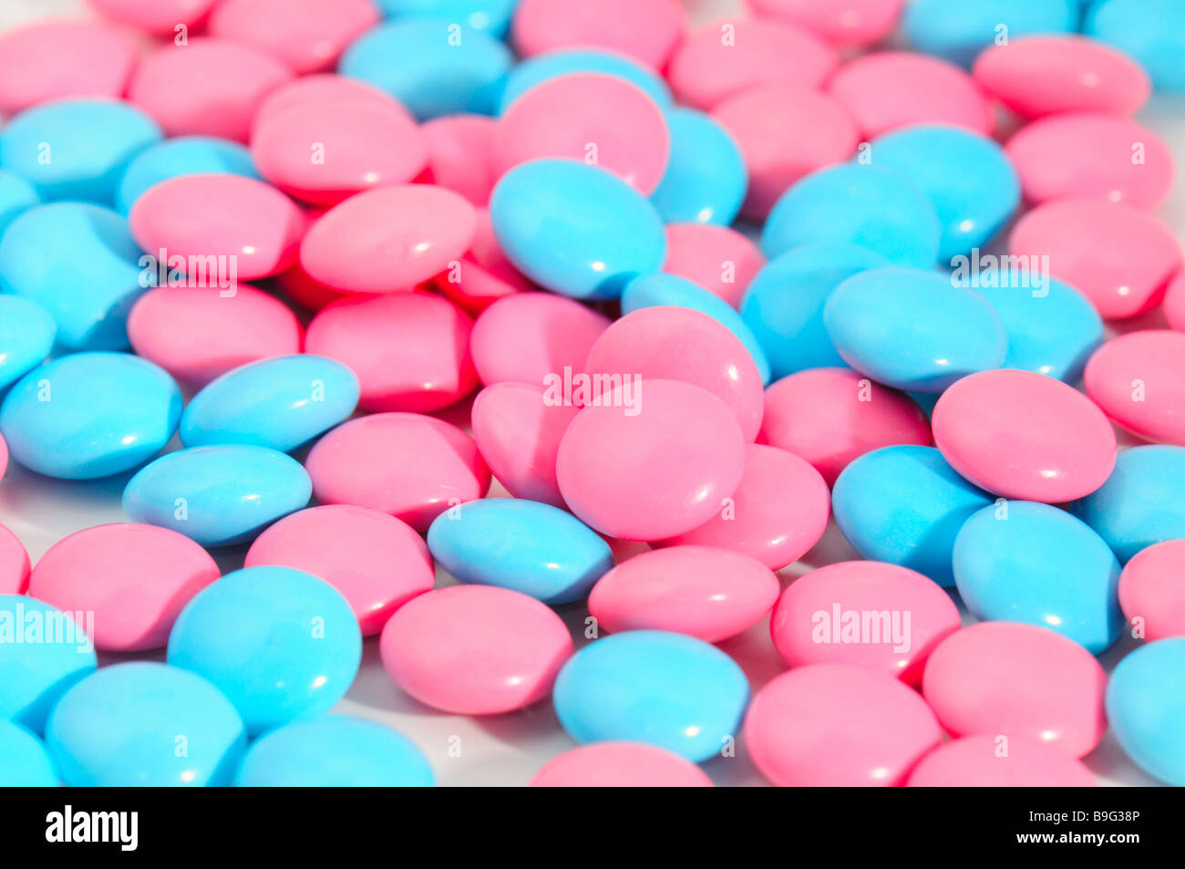 red and blue pills on white background Macro - Stock Image
