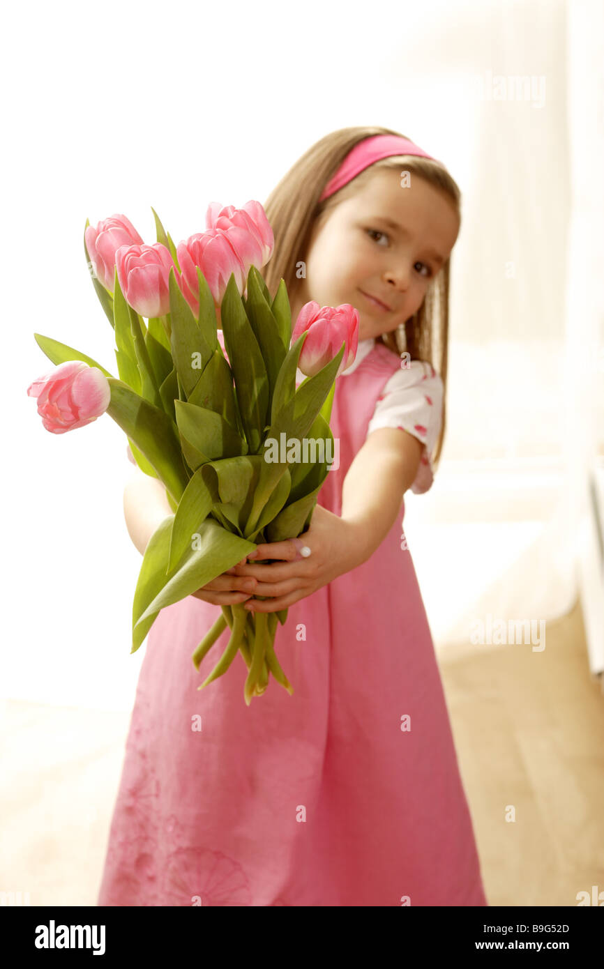5-8 years gaze camera flowers flower-bouquet detail color-mood pink cheerfully spring spring-flowers spring-bouquet Stock Photo