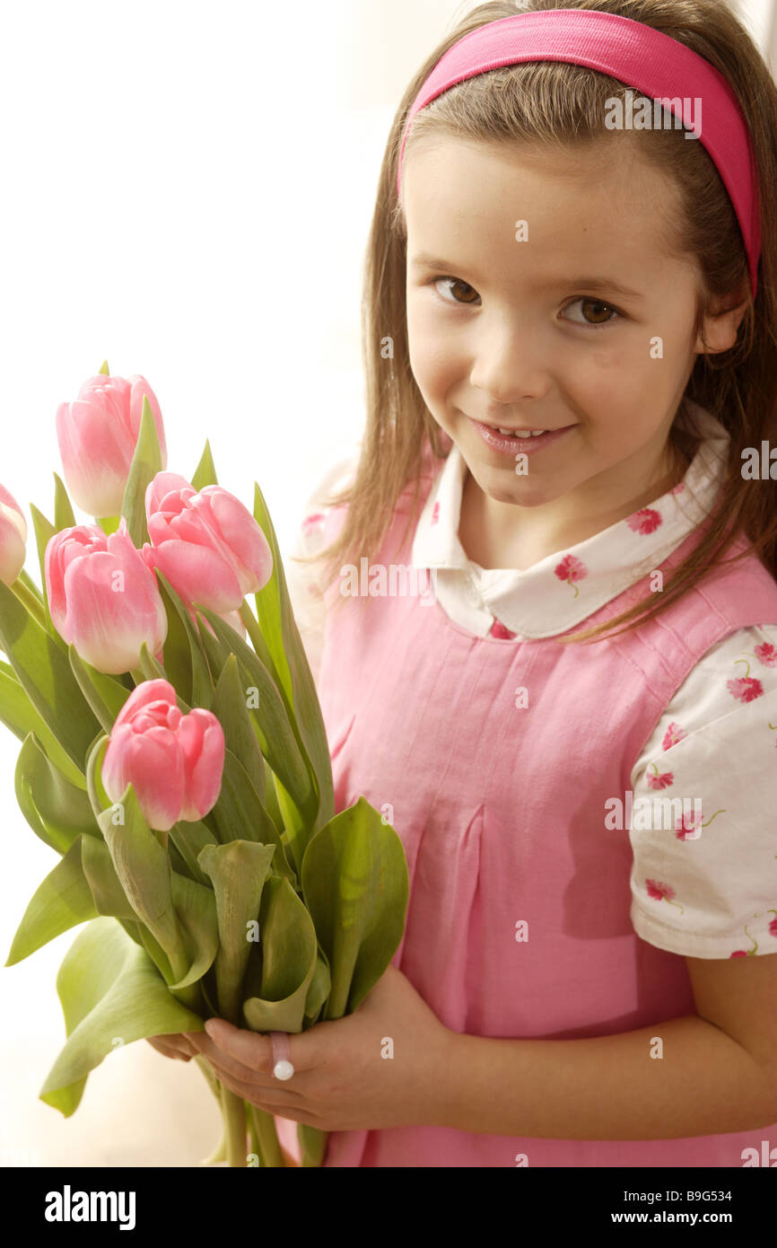 5-8 years broached gaze camera flowers flower-bouquet color-mood pink cheerfully spring spring-flowers spring-bouquet Stock Photo
