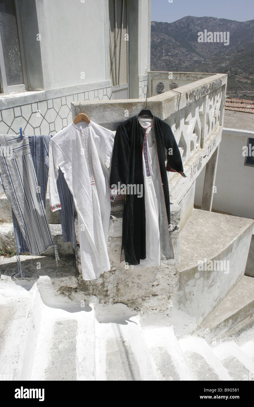 Greece Karpathos Olympos residence airs Falkon garments Dodecanese Island buildings house balcony-parapet clothes - Stock Image