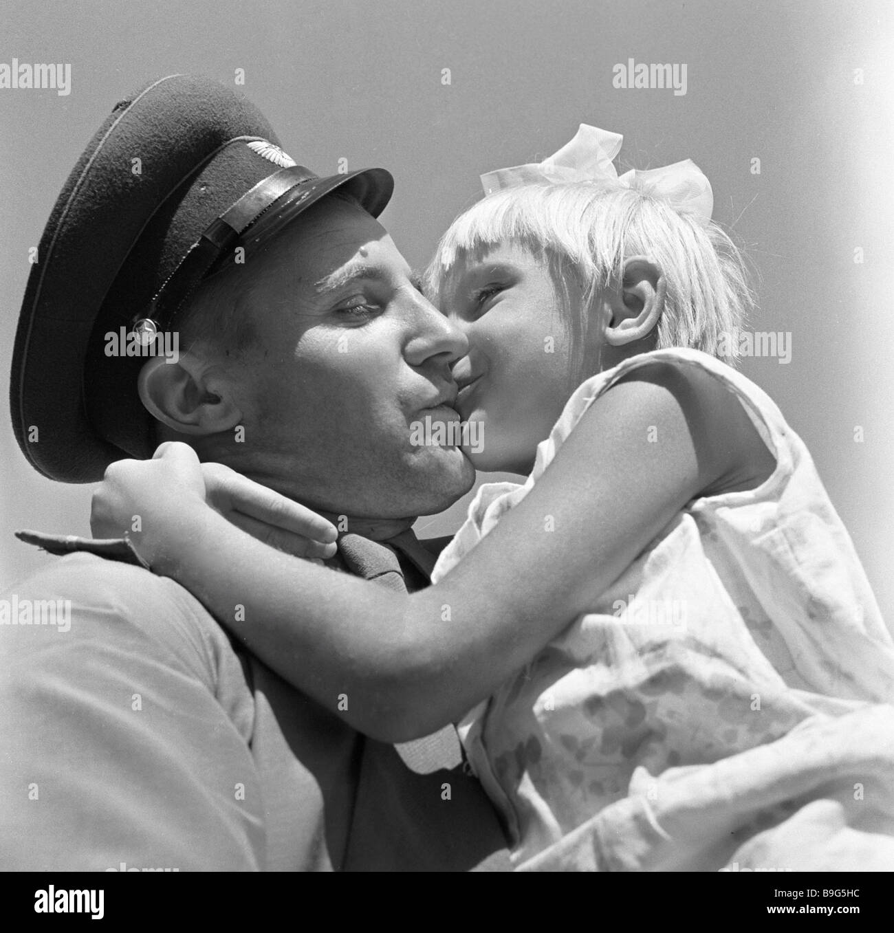 A participant in the Soviet Chinese border conflict meeting with his daughter after hospital discharge - Stock Image