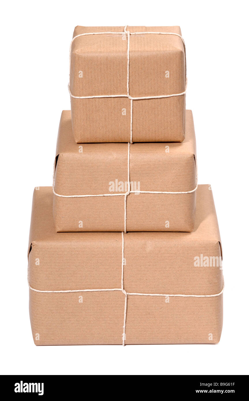 Three brown paper parcels - Stock Image