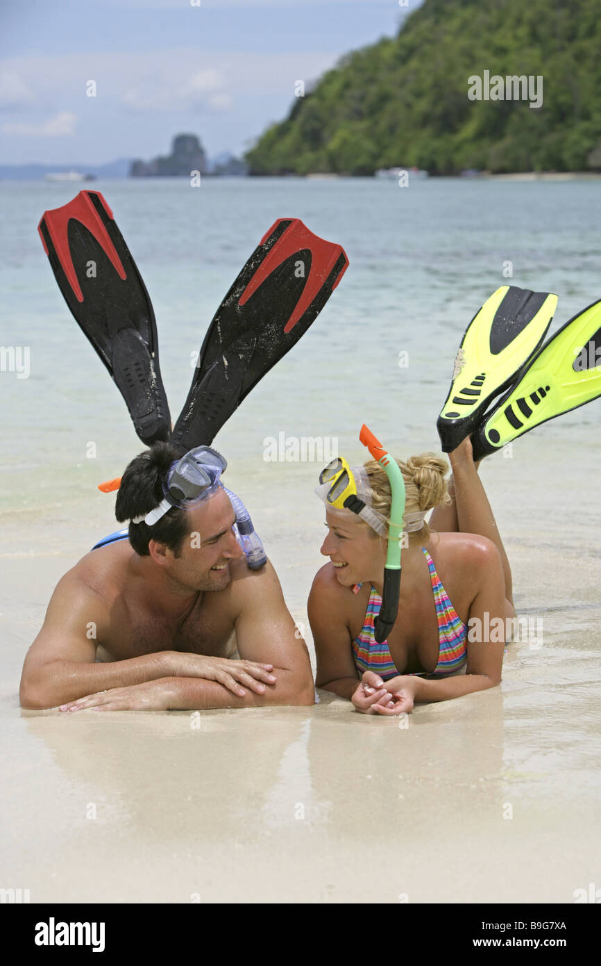 Liveliness bath-clothing bathing beach-holidays touch relationship relaxation relaxation flirt fins leisure time - Stock Image