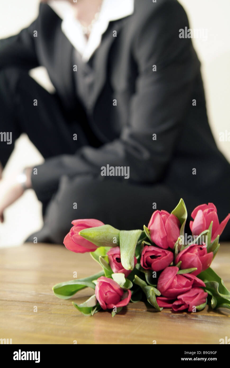 Apology flowers stock photos apology flowers stock images alamy sits man suit flower bouquet waits broached series people rendezvous falling in love flowers tulips izmirmasajfo
