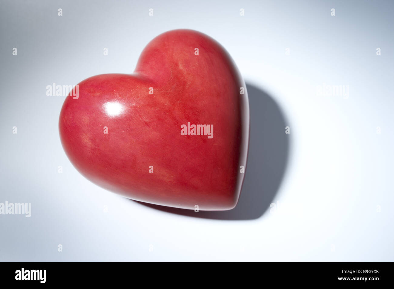 Entrusts paperweights feeling coldness gift ground smoothly brilliantly hard hard-hearted heart heart of stone heart - Stock Image