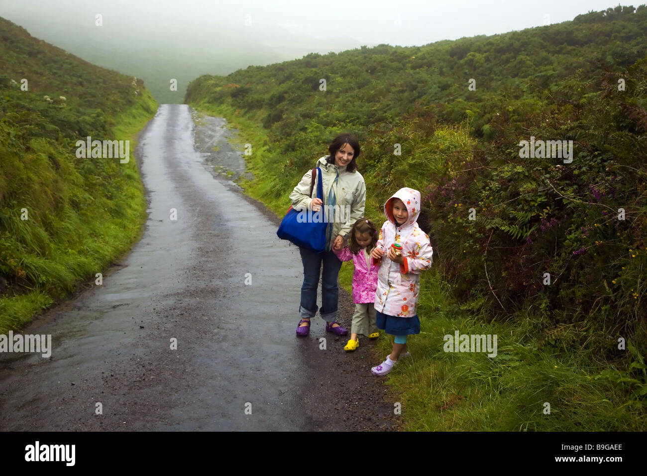 Mother and Daughters in wet weather on Cape Clare Island , Ireland - Stock Image