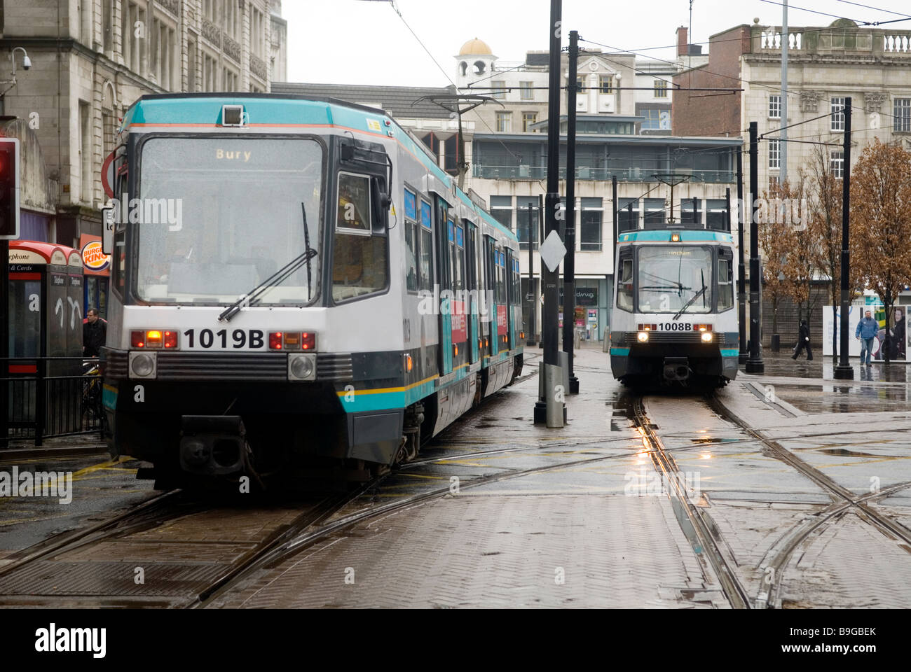 Trams in Piccadilly gardens Manchester city centre UK - Stock Image
