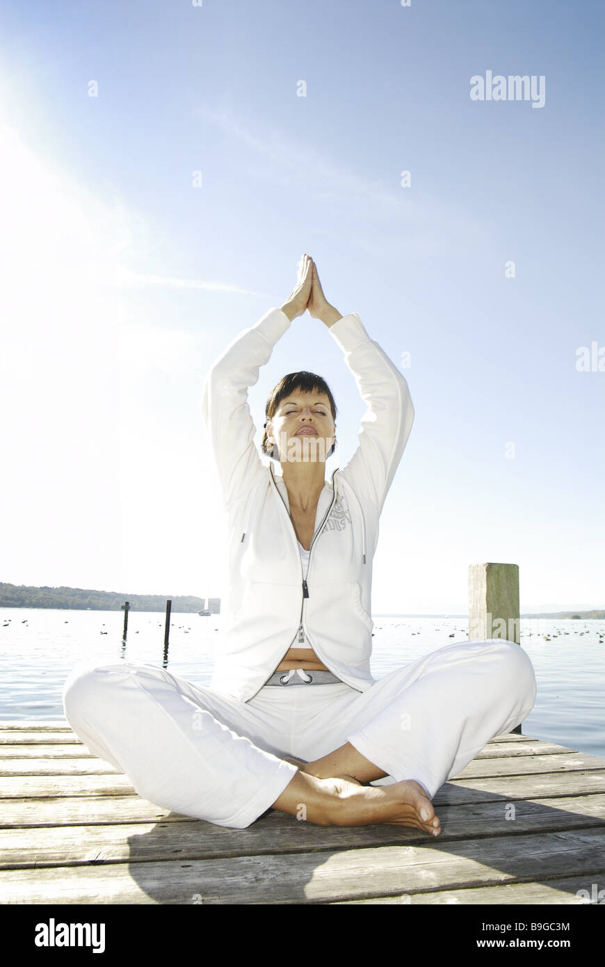 30-40 years alone balance outside barefoot brunette deeply-breathing relaxation recuperation woman leisure time - Stock Image