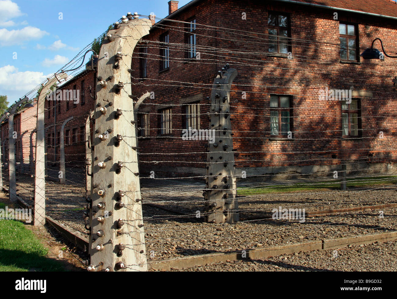 Nazi concentration camp Auschwitz-Birkenau  electrified triple barbed wire fence corridor between prison block fences - Stock Image
