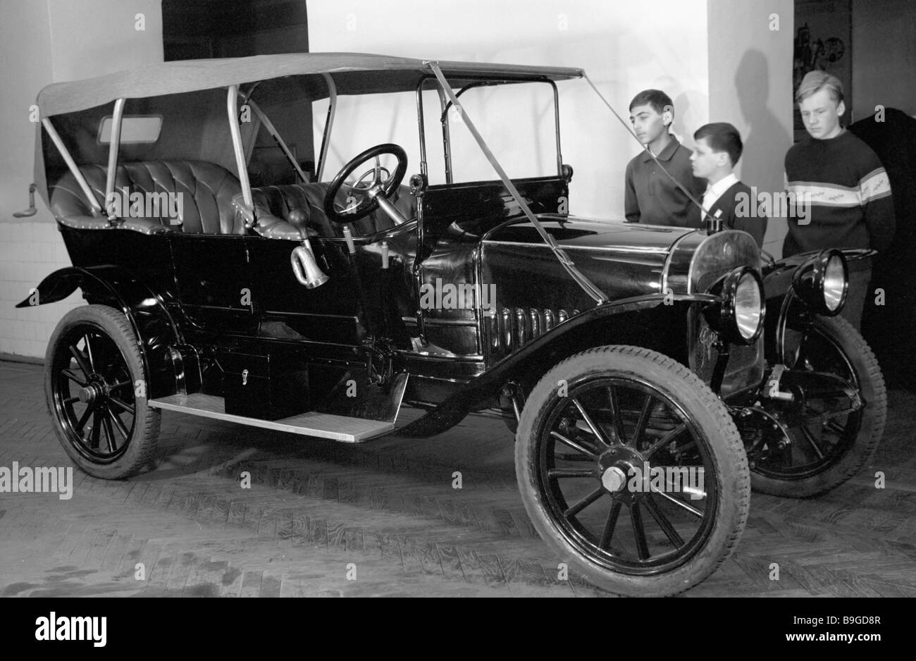 Boys inspect automobile made by Russo Balt Factory in Polytechnical ...