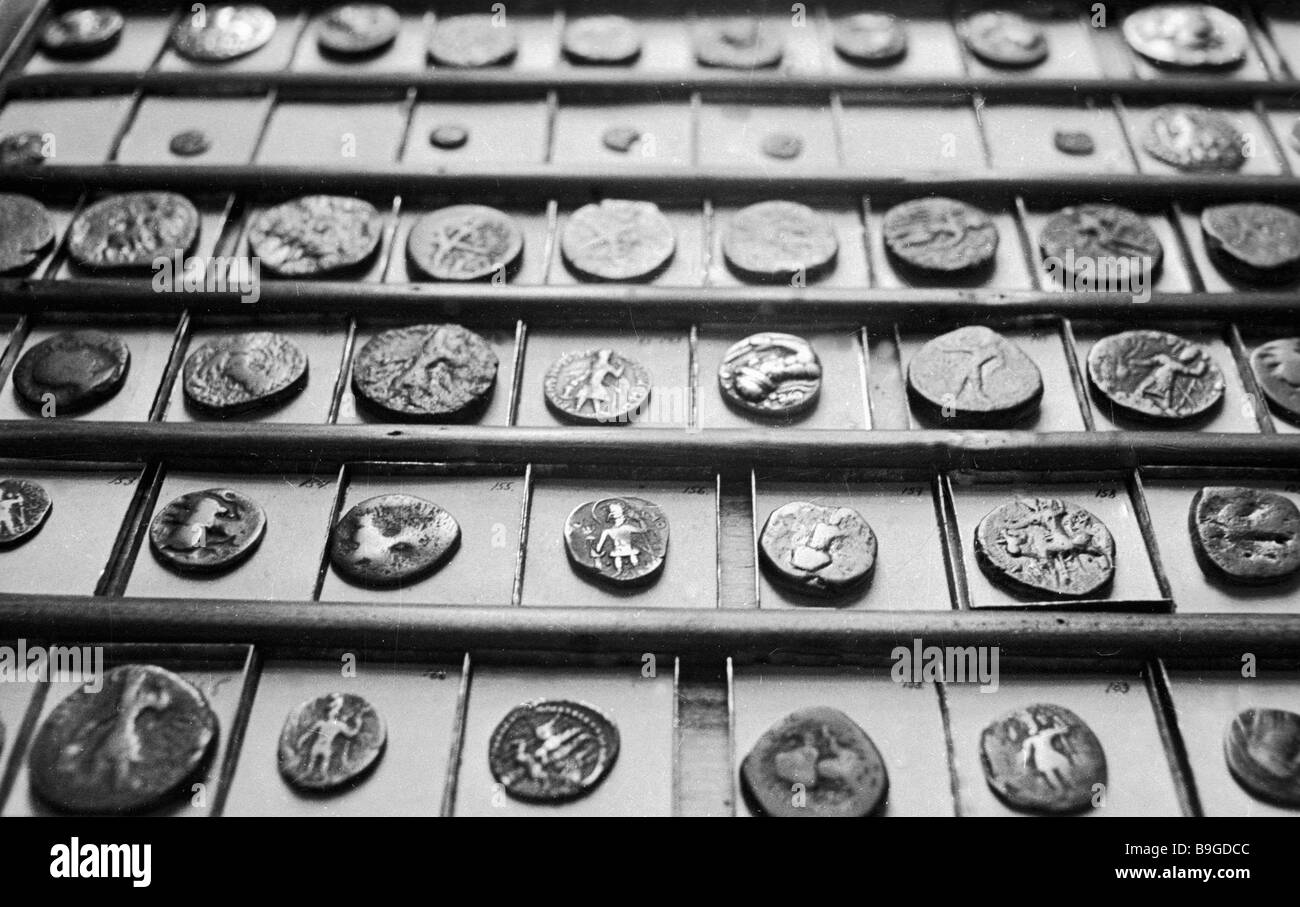 A showcase in the numismatics department of the historical museum in Samarkand - Stock Image