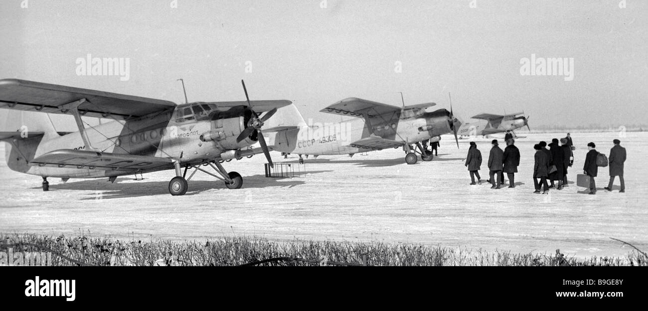 Passengers boarding an An 2 plane at Vinnitsa Airport - Stock Image