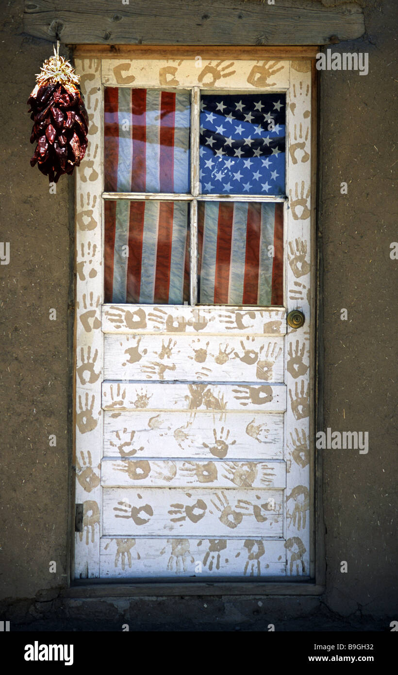 Door with American flag and hand prints. Taos Pueblo New Mexico USA. & Door with American flag and hand prints. Taos Pueblo New Mexico ...