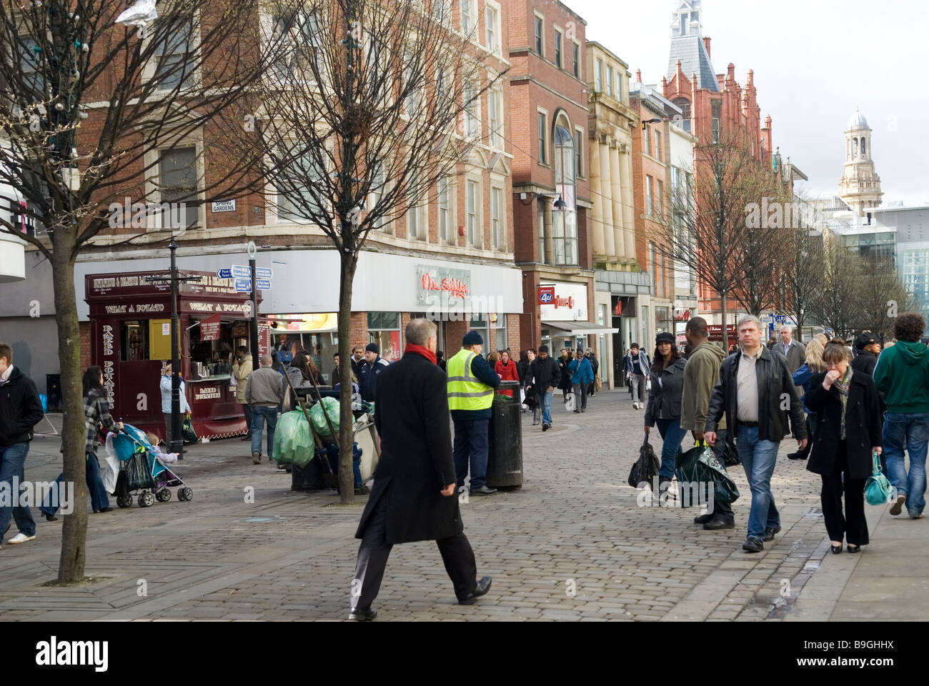 People walking in market street Manchester city centre UK - Stock Image