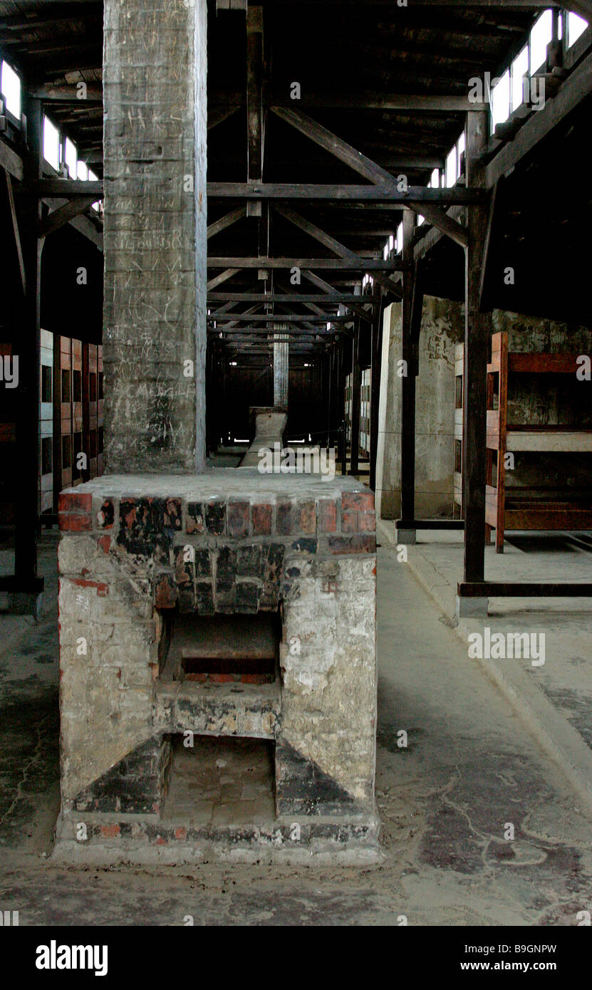 Nazi camp Auschwitz- II-Birkenau interior barrack originally designed as a stable for fifty two horses, brick stove - Stock Image